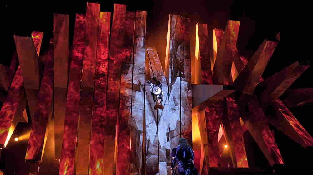 Brünnhilde (center) is surrounded by fire at the end of Wagner's Die Walküre — part of the Met's current Ring cycle, produced by Robert Lepage.