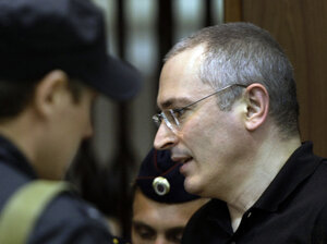 Former Yukos CEO Mikhail Khodorkovsky walks into court in Moscow, Russia, May 24, 2011. A Moscow appeals court upheld the second conviction of Khodorkovsky, reducing his prison sentence by one year for a total of 13 years. He will be released in 2016.