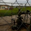 A working gas well head is fenced in just opposite of a home in Dish, Texas. Dish is about 30 miles north of Fort Worth.