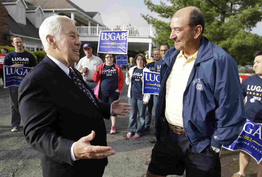 Sen. Richard Lugar talks with Joe Purichia before voting on Tuesday in Greenwood, Ind.