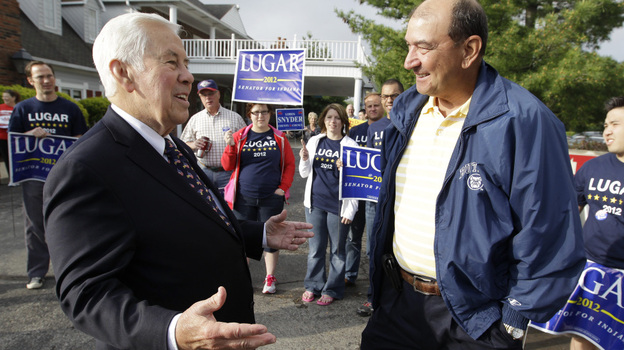 Sen. Richard Lugar talks with Joe Purichia before voting on Tuesday in Greenwood, Ind. (AP)