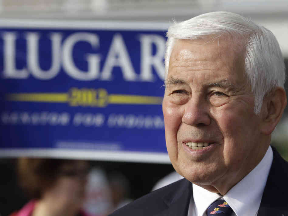 Sen. Richard Lugar, R-Ind., meets with voters Tuesday outside of a polling place in Greenwood, Ind. Lugar is being challenged in the Republican primary by Indiana Treasurer Richard Mourdock.