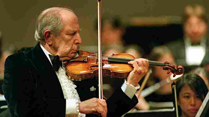 Roman Totenberg plays the violin solo for his 90th-birthday concert celebration onstage at Boston University's Tsai Performance Center.