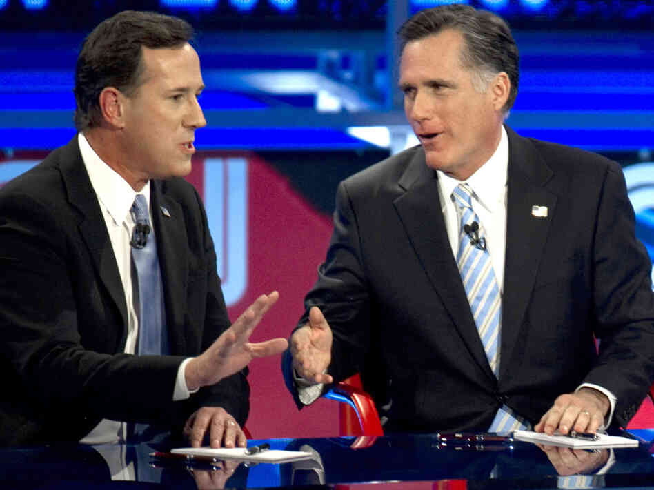 Back in their sparring days: Rick Santorum (left) and Mitt Romney during a Feb. 22, 2012, Republican presi