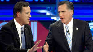 Back in their sparring days: Rick Santorum (left) and Mitt Romney during a Feb. 22, 2012, Republican presidential debate in Arizona.