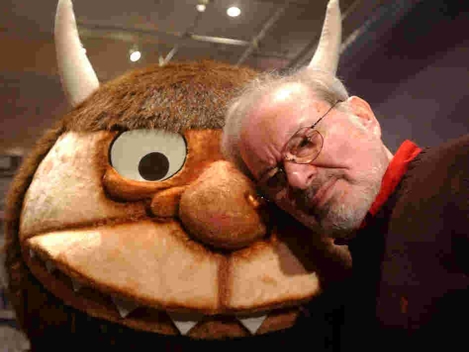 "Maurice Sendak stands with a character from his book ""Where the Wild Things Are,"" in 2002."