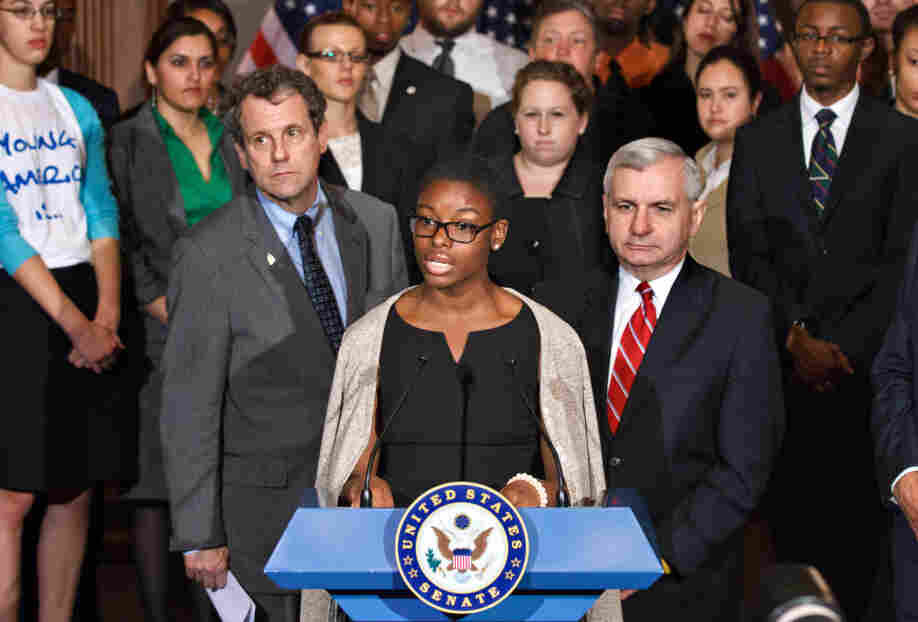 Howard University political science major Clarise McCants, flanked by Democratic Sens. Sherrod Brown and Jack Reed (right), addresses upcoming changes in federal Stafford loan interest rates at a Capitol Hill news conference Tuesday.