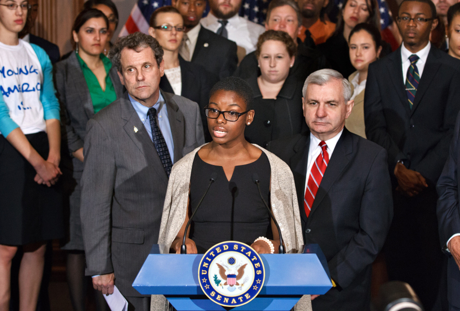 Howard University political science major Clarise McCants, flanked by Democratic Sens. Sherrod Brown and Jack Reed (right), addresses upcoming changes in federal Stafford loan interest rates at a Capitol Hill news conference Tuesday. (J. Scott Applewhite/AP)