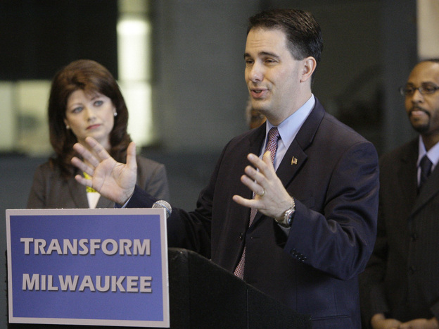 "Gov. Scott Walker announces the $100 million ""Transform Milwaukee"" initiative at Hatco Corp. in Milwaukee on April 30, along with Lt. Gov. Rebecca Kleefisch and Workforce Development Director Reggie Newson. Walker faces a recall election June 5."