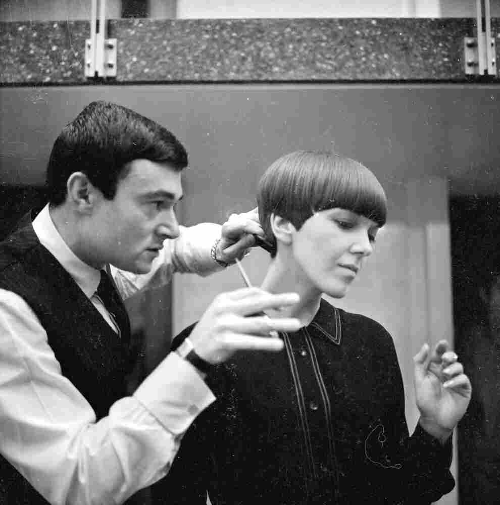 Clothes designer Mary Quant, one of the leading lights of the British fashion scene in the 1960's, having her hair cut by another fashion icon, hairdresser Vidal Sassoon in 1964.