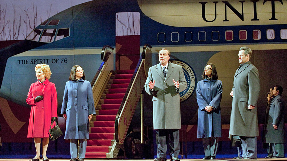 John Adams' Nixon in China, produced at the Metropolitan Opera in January 2011. Left to right: Janis Kelly as Pat Nixon, Teresa S. Herold as the Second Secretary to Mao, James Maddalena as Richard Nixon, Ginger Costa Jackson as the First Secretary to Mao, Russell Braun as Chou En-lai. (Metropoltan Opera)