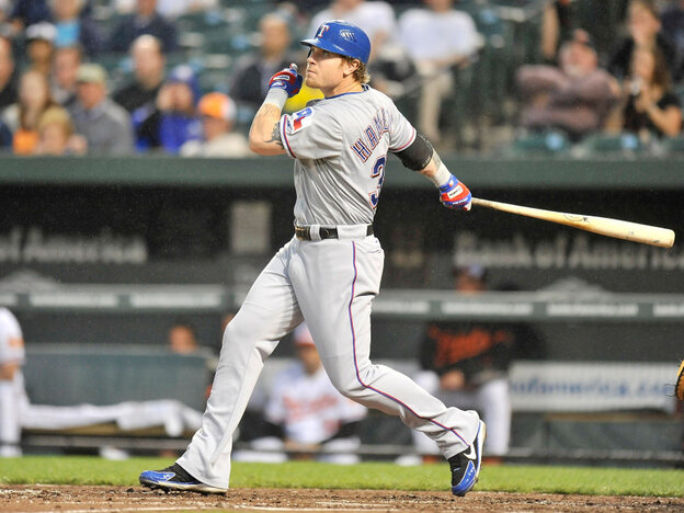 There goes No. 2: Josh Hamilton of the Texas Rangers as he hit the second of his four home runs Tuesday night in a game vs. the Baltimore Orioles.