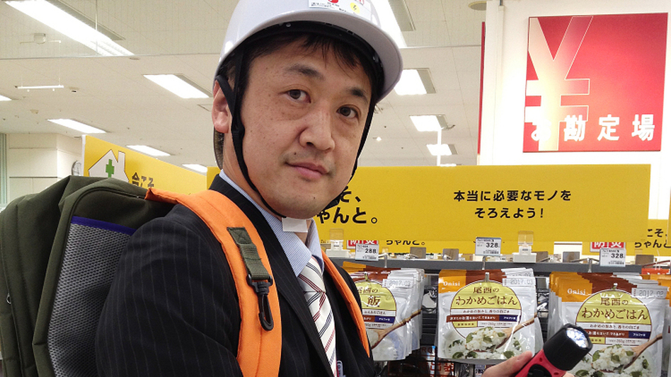 Store manager Naoto Higashi models a helmet, a fully stocked kit in his backpack, and a windup flashlight. Such items have become popular in Japan following last year's huge earthquake and tsunami.
