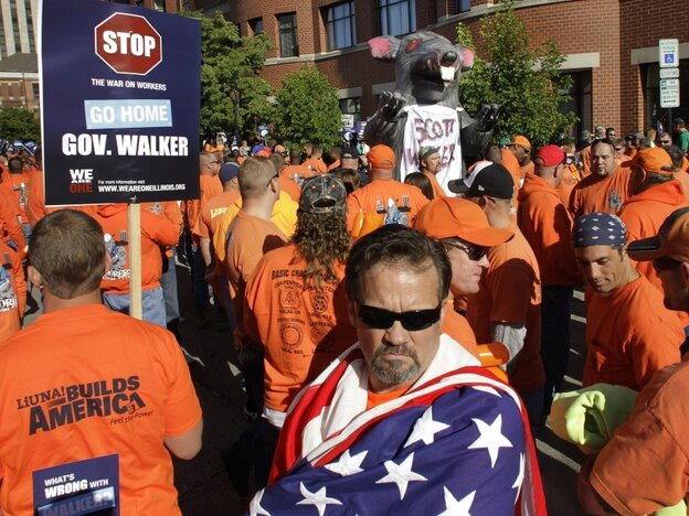 Protesters march outside the Abraham Lincoln Presidential Hotel where Wisconsin Gov. Scott Walker is speaking to the Illinois Chamber of Commerce on April 17 in Springfield, Ill. Walker faces Democrat Tom Barrett in a recall election June 5. The events in the state over the next four weeks could be a sign of where the U.S. is headed in the months ahea