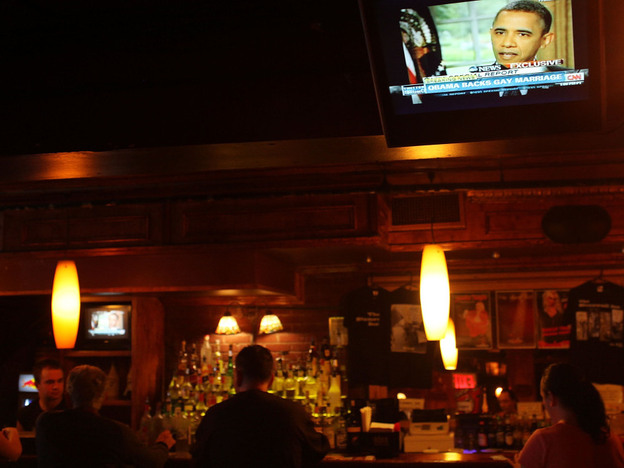 President Obama was on a TV monitor at the Stonewall Inn in New York City, a key historic site of the gay-rights movement. (Getty Images)