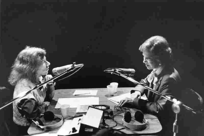 Terry interviewing Rosalynn Carter. Carter's 1994 book, Helping Yourself Help Others: A Book for Caregivers, is on the table between the two women.