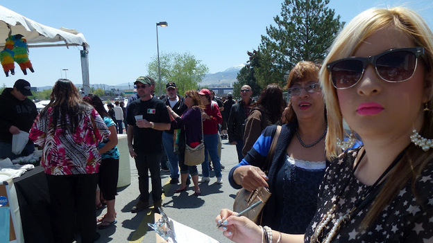 Caroline Maya, a 21-year-old college student, registers to vote for the first time at the Latinos for Obama booth outside the Grand Sierra Casino in Reno, Nev., Saturday. (NPR)