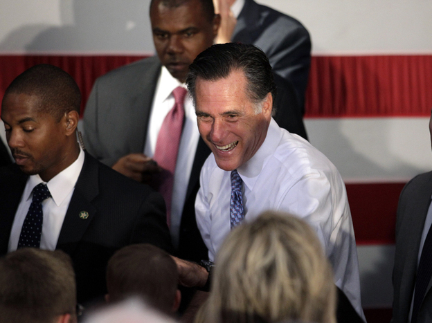 Republican presidential candidate Mitt Romney greets supporters at a campaign stop in Omaha, Neb.,on Thursday.