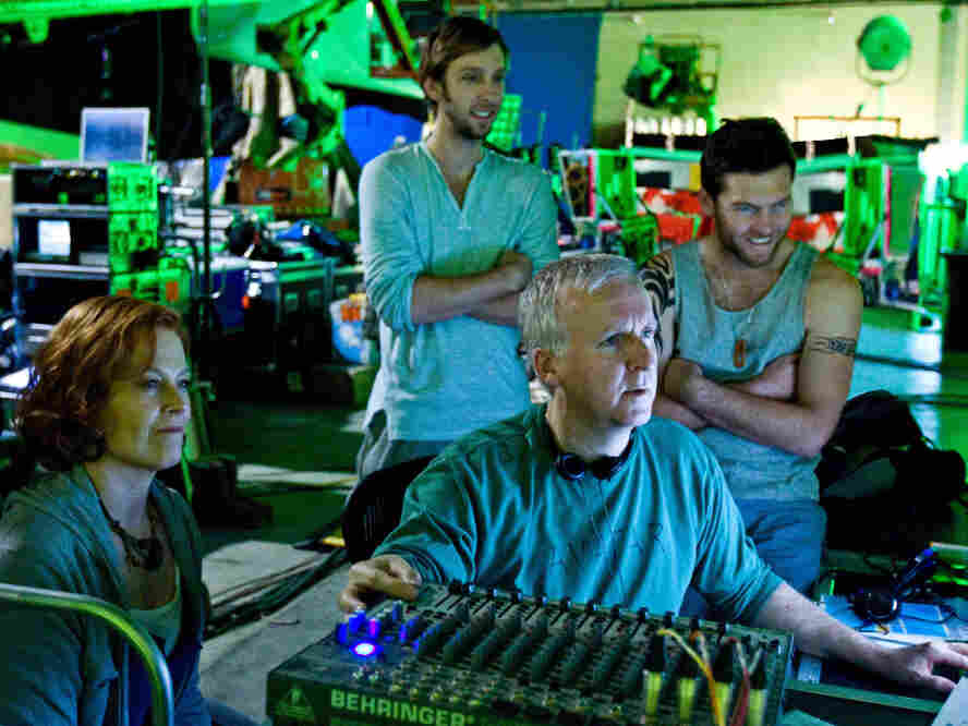 Writer-director James Cameron on the set of 2009's Avatar with cast members Sigourney Weaver, Joel David Moore, and Sam Worthington.
