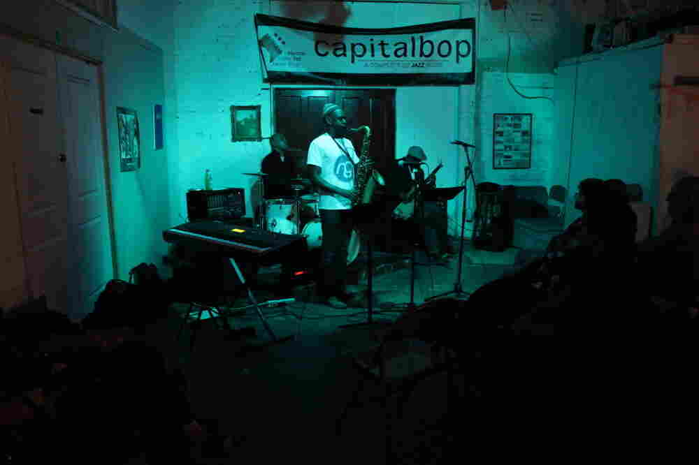 Mad Curious, with drummer Lenny Robinson, saxophonist Brian Settles and bassist Tarus Mateen, performs at a Capitalbop house show.