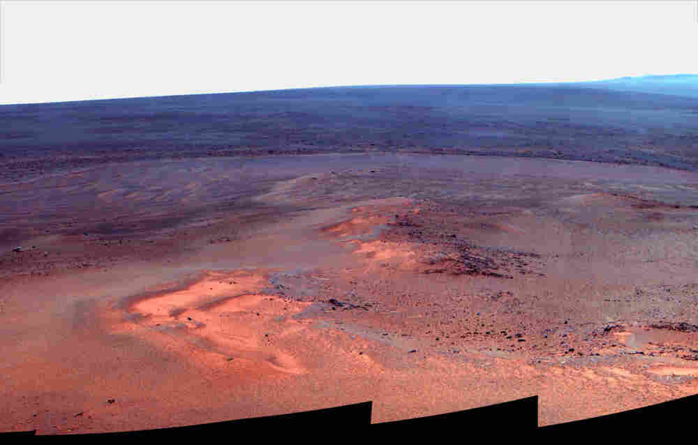 """A mosaic of images taken in January 2012 shows Opportunity's vista north (left) and northeast (right), in an outcrop known as """"Greeley Haven,"""" where the rover spent its fifth  Martian winter. The image released by NASA is presented in """"false color,"""" to make differences in the landscape easier to see."""