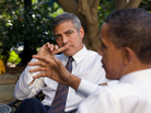President Obama talks with actor George Clooney during a White House meeting about Sudan in 2010. The president is attending a fundraiser at Clooney's house Thursday, along with a few sweepstakes winners.