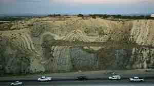 Layers of earthquake-twisted ground are seen where the 14 freeway crosses the San Andreas Fault near Palmdale, Calif. The San Andreas Fault, like the kind that caused the huge earthquake off the coast of Indonesia, is a strike-slip fault, where the tectonic plates slide past each other.