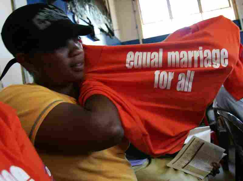 A lesbian woman shows off her t-shirt with the slogan 'Equal marriage for all, nothing less' at a debate on the civil union bill conducted in English, Zulu and Sotho, in Soweto 20 September 2006.