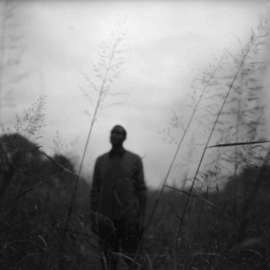 A young man stands alone in a field near his home in Mound Bayou, November 2011.