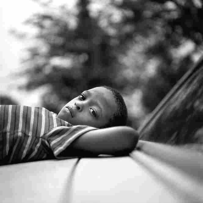 Reclining on a car in Duncan, June 2009.