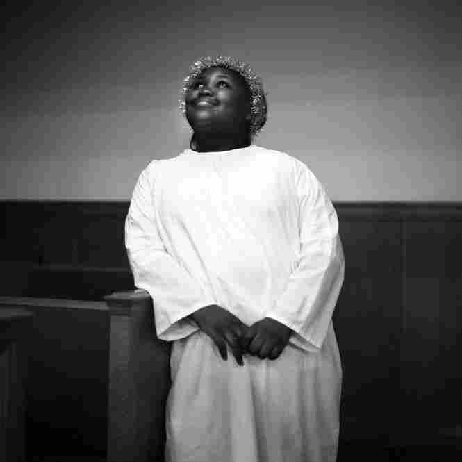 Dressed as an angel, a young girl poses for a portrait after the First Baptist Church of Mound Bayou's Christmas Eve celebration, 2010.