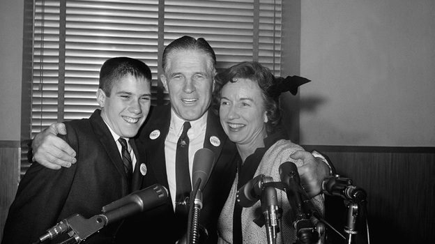 Mitt Romney, then 14, with his father, George, and mother, Lenore, in 1962. (AP)