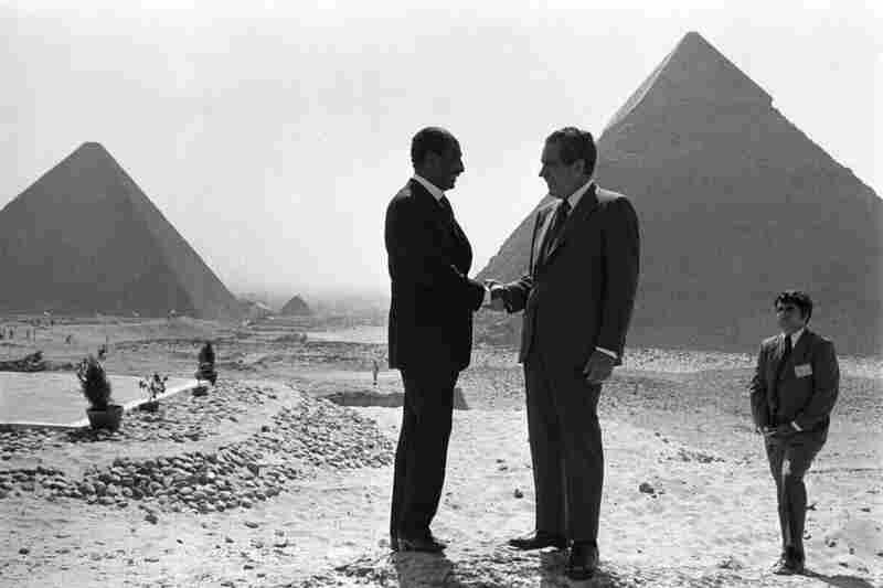 Presidents Anwar Sadat and Richard Nixon shake hands in front of the pyramids at Giza, near Cairo, June 1974.