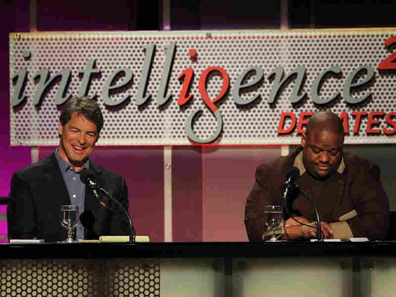Tim Green (left) and Jason Whitlock argue against banning college football at a May 8 Intelligence Squared debate.
