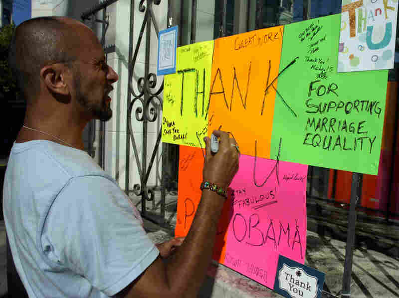 "Kelly Rivera Hart of San Francisco, California, adds his thoughts to a ""thank you"" card for President Obama posted at the intersection of Castro and 18th Streets in San Francisco on Wednesday, May 9. Obama spoke earlier in the day of his personal beliefs on gay marriage."