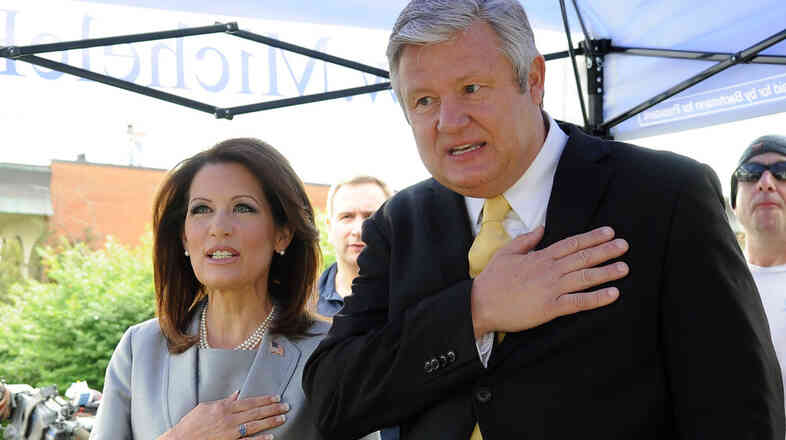 Minnesota Republican Rep. Michele Bachmann and her husband, Marcus, recite the Pledge of Allegiance before announcing her candidacy for president last June in Waterloo, Iowa.