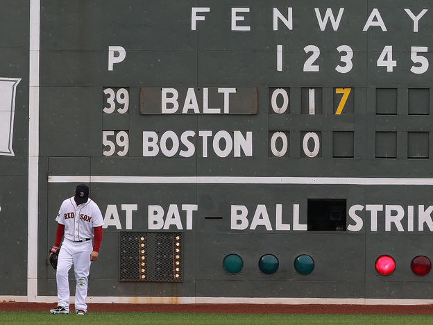 Boston Red Sox left fielder Cody Ross looks down during a seven-run third inning against the Baltimore Orioles at Fenway Park on May 5. The Red Sox trail their division, losing 11 of their last 12 home games.