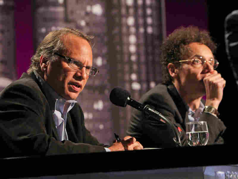 Buzz Bissinger (left) and Malcolm Gladwell argue for banning college football in an Intelligence Squared U.S. debate.