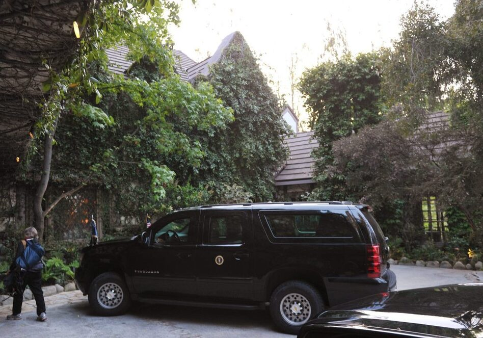 A presidential SUV is seen outside of the house of actor George Clooney on Thursday in Los Angeles. (Mandel Ngan /AFP/Getty Images)
