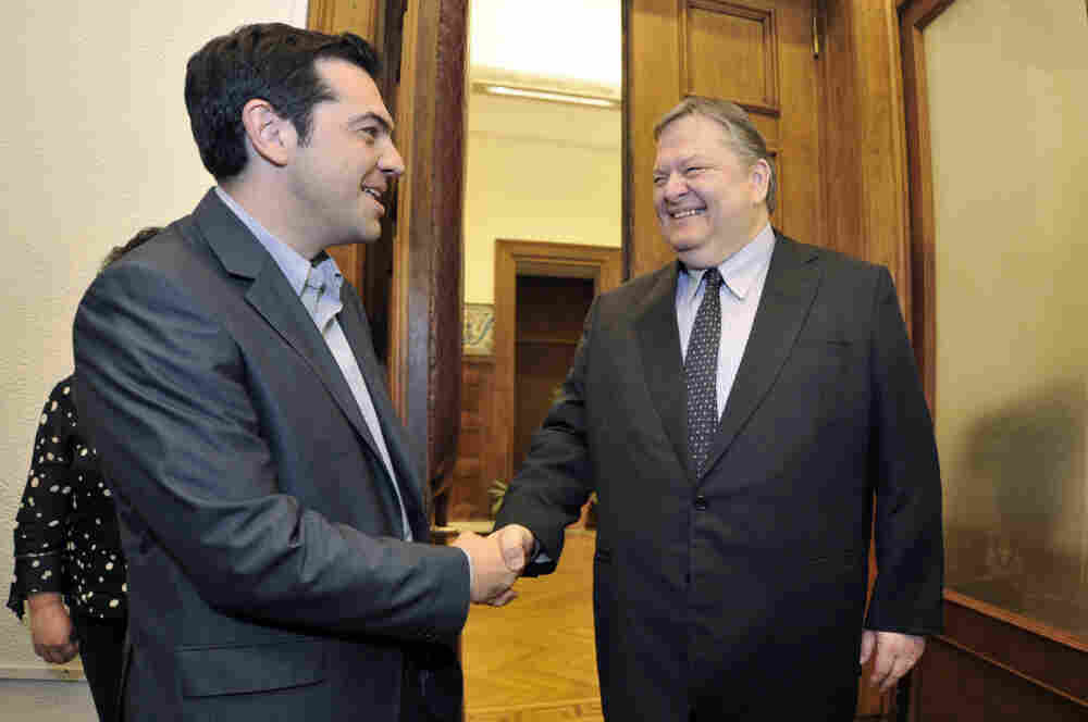 Greece's radical leftist party Syriza chief Alexis Tsipras (L) shakes hands with Socialists leader Evangelos Venizelos before their meeting at the Greek parliament in Athens on Friday. Venizelos admitted that he had failed in a last-ditch bid to form a government after Syriza key leftist party ruled out joining a pro-austerity coalition.