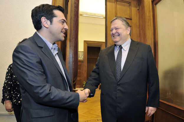 Greece's radical leftist party Syriza chief Alexis Tsipras (L) shakes hands with Socialists leader Evangelos Venizelos before their meeting at the Greek parliament in Athens on Friday. Venizelos admitted that he had failed in a last-ditch bid to form a government after Syriza key leftist party ruled out joinin