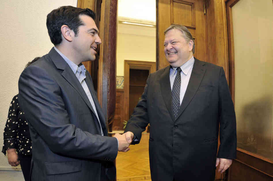 Greece's radical leftist party Syriza chief Alexis Tsipras (L) shakes hands with Socialists leader Evangelos Venizelos before their meeting at the Greek parliament in Athens on Friday. Venizelos admitted that he had failed in a last-ditch bid to form a
