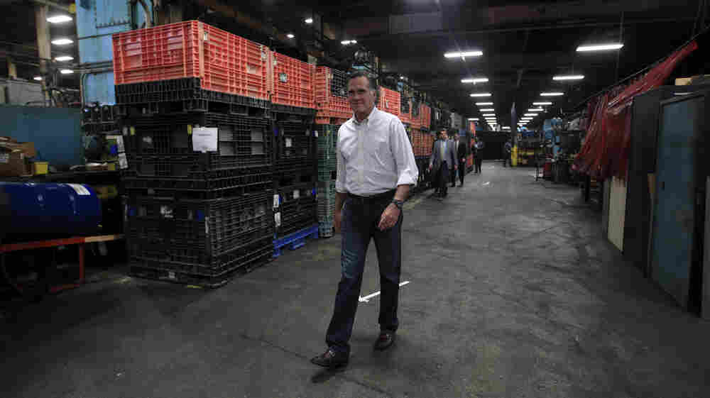 Republican presidential candidate Mitt Romney arrives for a town hall-style meeting at Stamco Industries, a truck parts supplier, in Euclid, Ohio, on Monday.