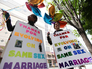 Marriage equality supporters Teri McClain (left) and Mary Beth Brotski demonstrate Thursday in Seattle.