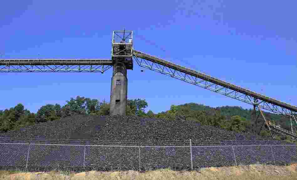 Coal piled near a conveyor at a mine near Meta, Ky., in August 2011.