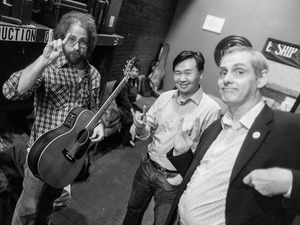 Jonathan Coulton, left, Art Chung and John Chaneski like to start each show by throwing up some horns backstage at The Bell House in Brooklyn, NY.
