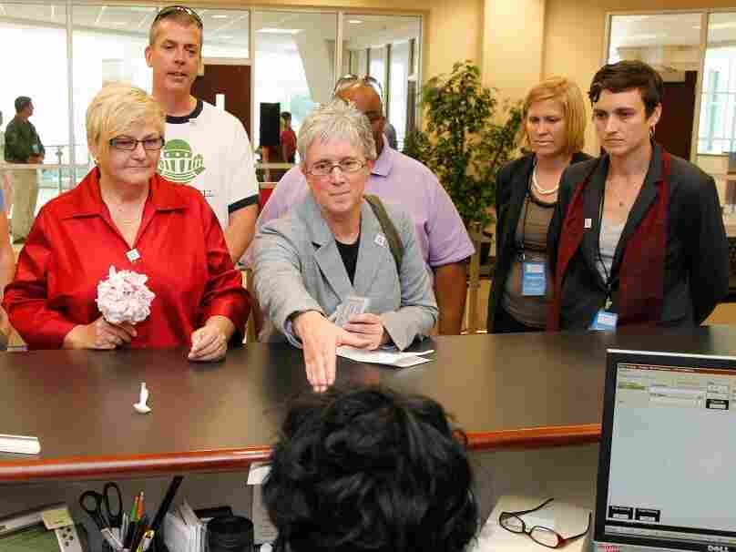 In protest of state law, a same-sex couple attempts to obtain a marriage license at the Forsyth County Register of Deeds office in Winston-Salem, N.C., Thursday, May 10.