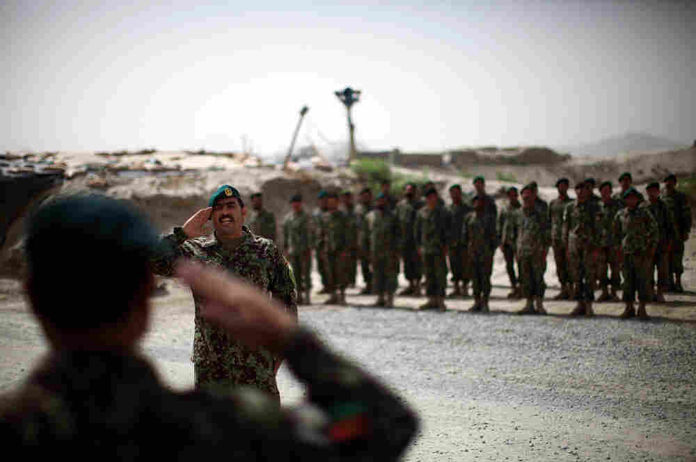 Brig. Gen. Ahmed Habbibi of the Afghan National Army salutes his soldiers in Panjwai district near Kandahar in southern Afghanistan.