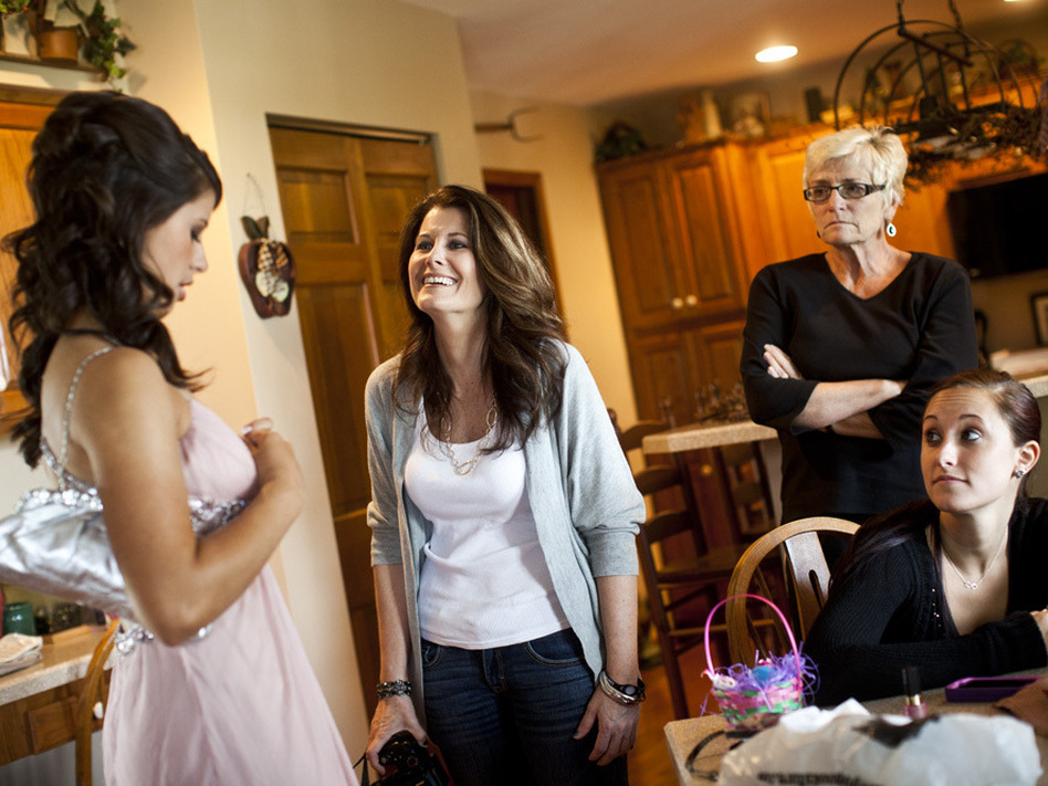 Kelley Hawkins (center) smiles at her daughter Carley (left) as her other daughter, Chelsea (right), looks on, in their family home in Harrisburg, Pa.
