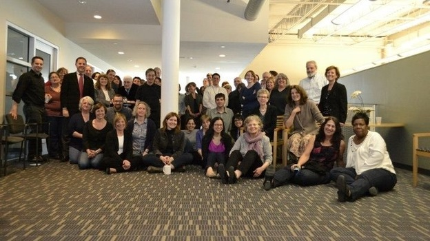 Fresh Air's staff, surrounded by employees of WHYY at their 25th-anniversary party.